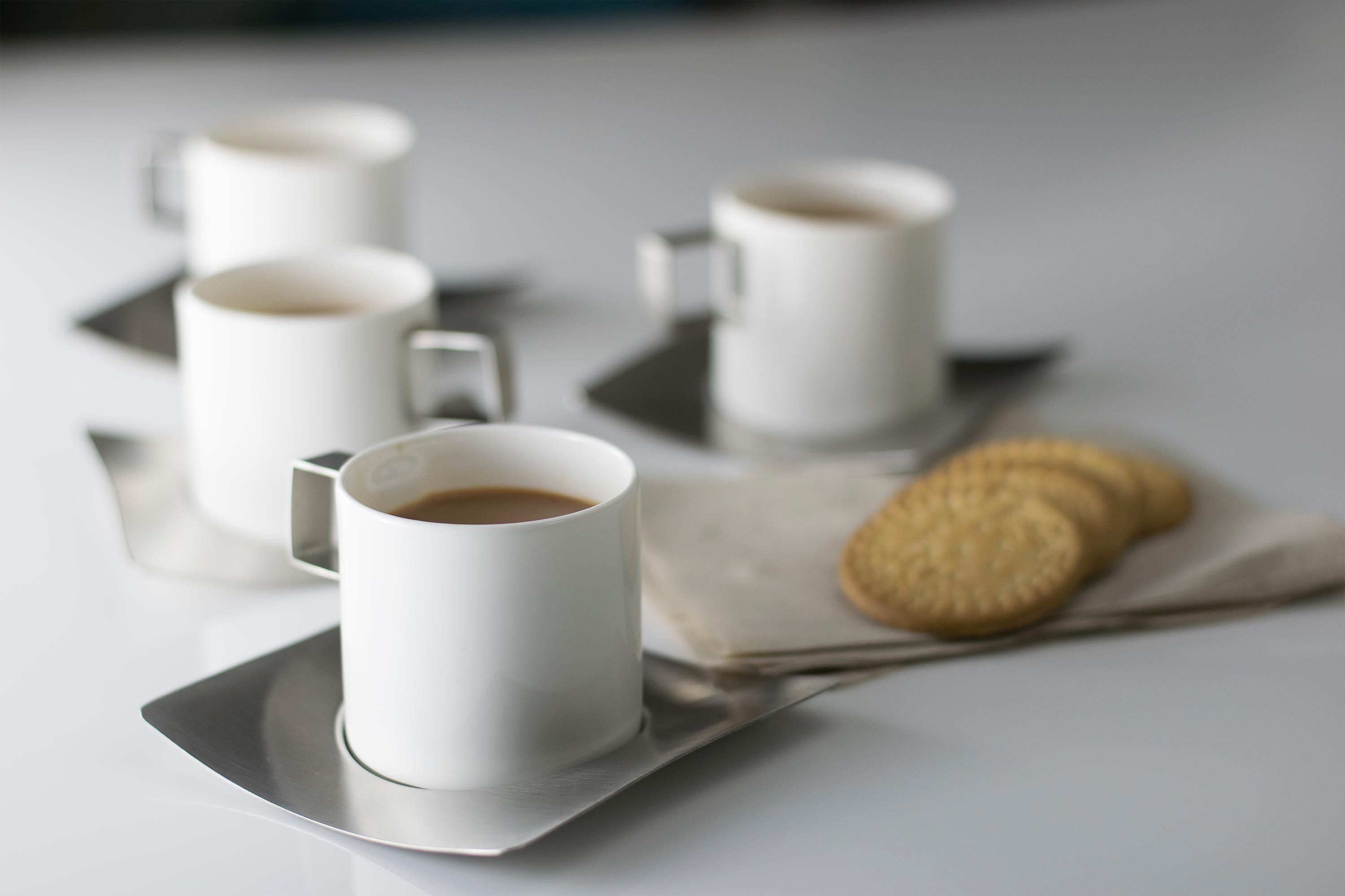 Hot Muggs Blanche Fine Bone China Cup with Stainless Steel Handle and Stainless Steel Saucer 200 ml, 8 Pc Stainless steel Cups & Saucers in White Colour by HotMuggs