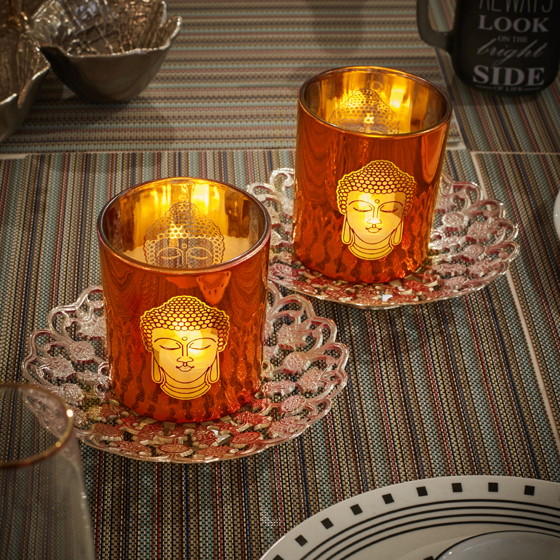 Zahara Set Of 2 Buddha Face Glass Candle Holders in Orange Colour by Living Essence