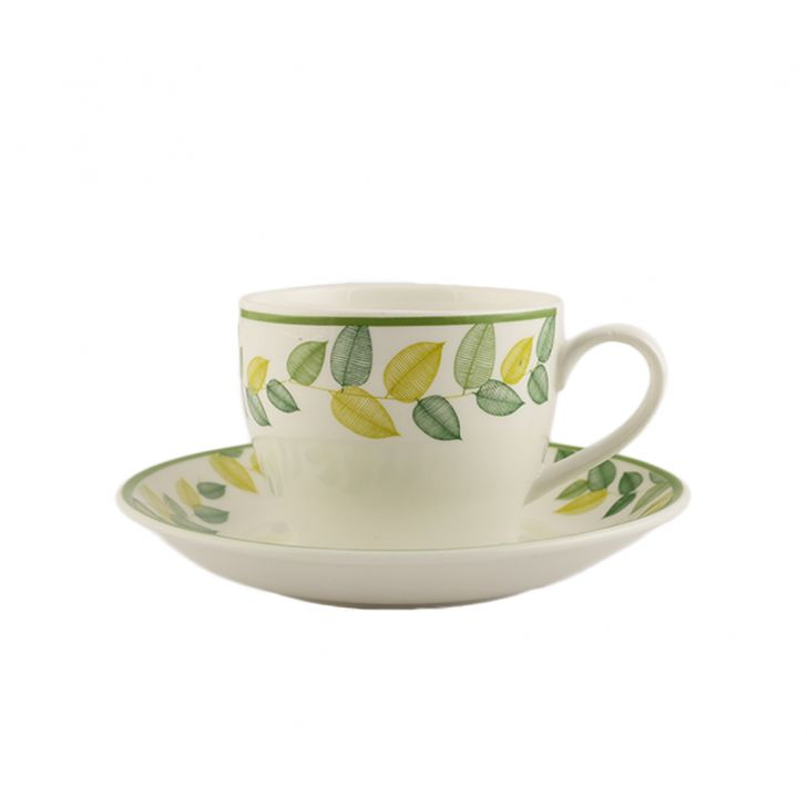 Petite Leaves Set Of 12 Cup & Saucer Ceramic Cups & Saucers in White And Green Colour by Living Essence