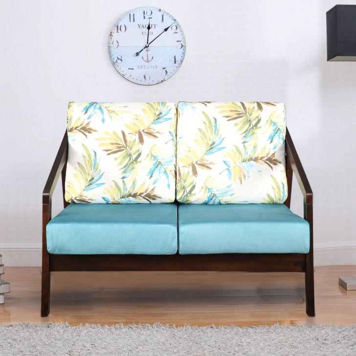Borris Solid Wood Two Seater Sofa With Cushion in Printed Teal Colour by HomeTown