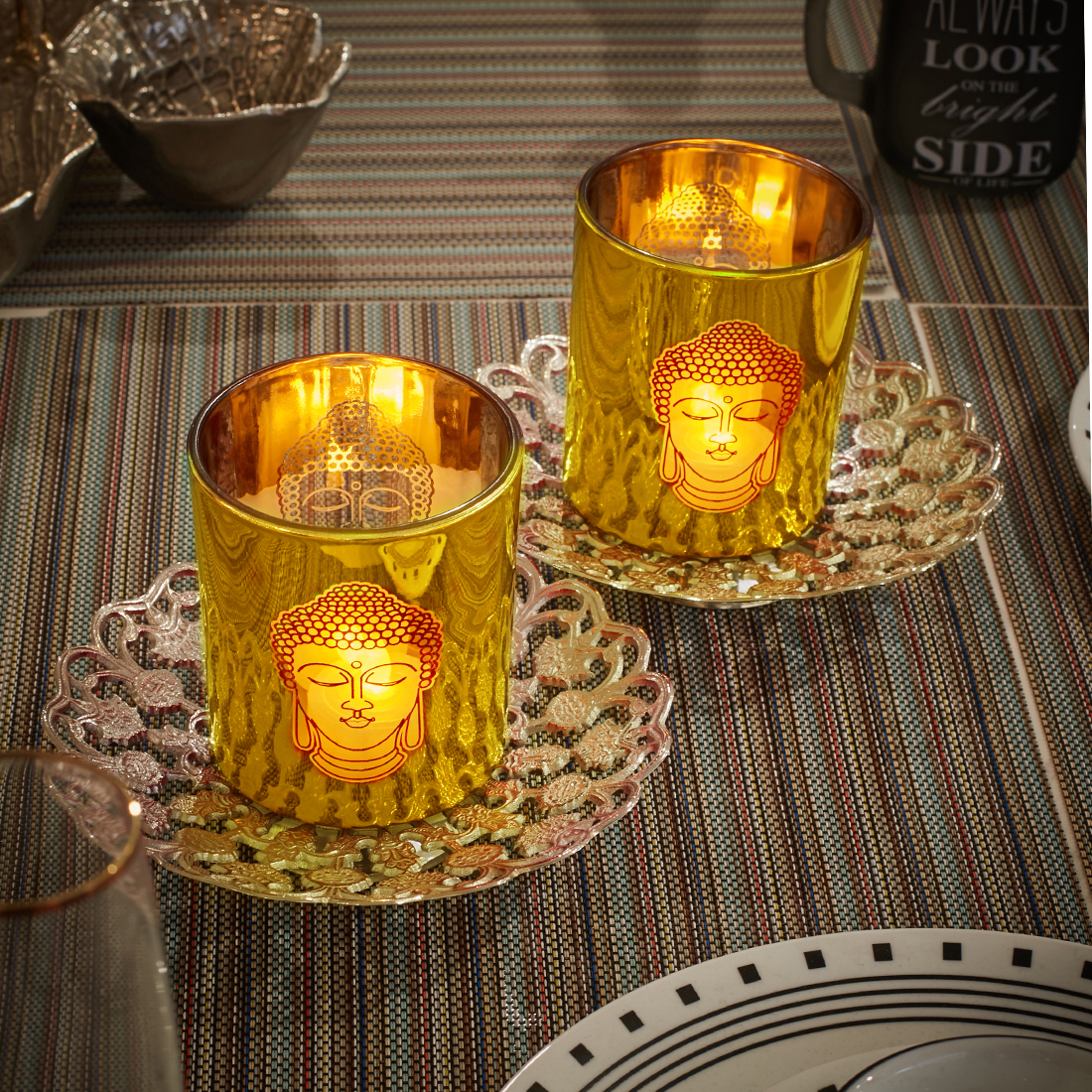 Zahara Large Set Of Two Gold Candle Holder With Etched Buddha Face Metal Candle Holders in Gold Colour by Living Essence