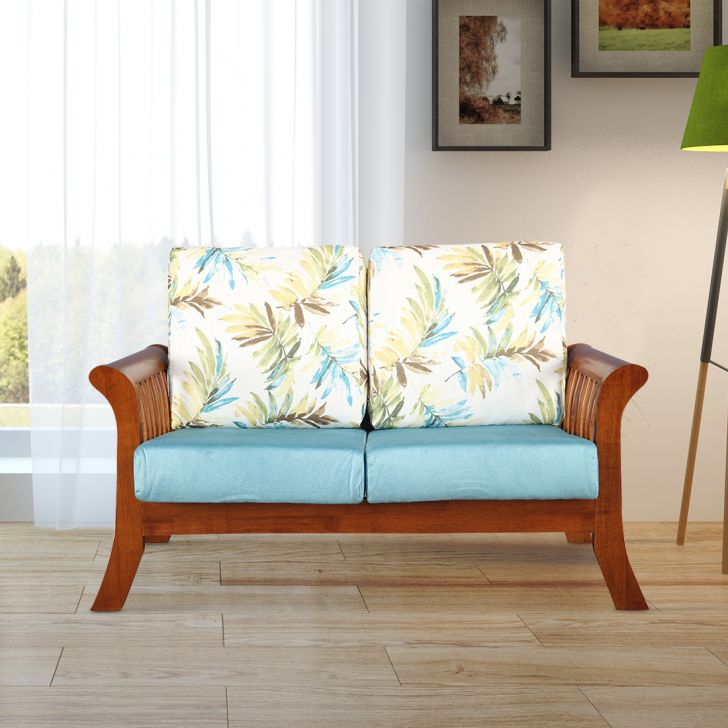 Aubrey Solid Wood Two Seater Sofa With Cushion in Printed Teal Colour by HomeTown