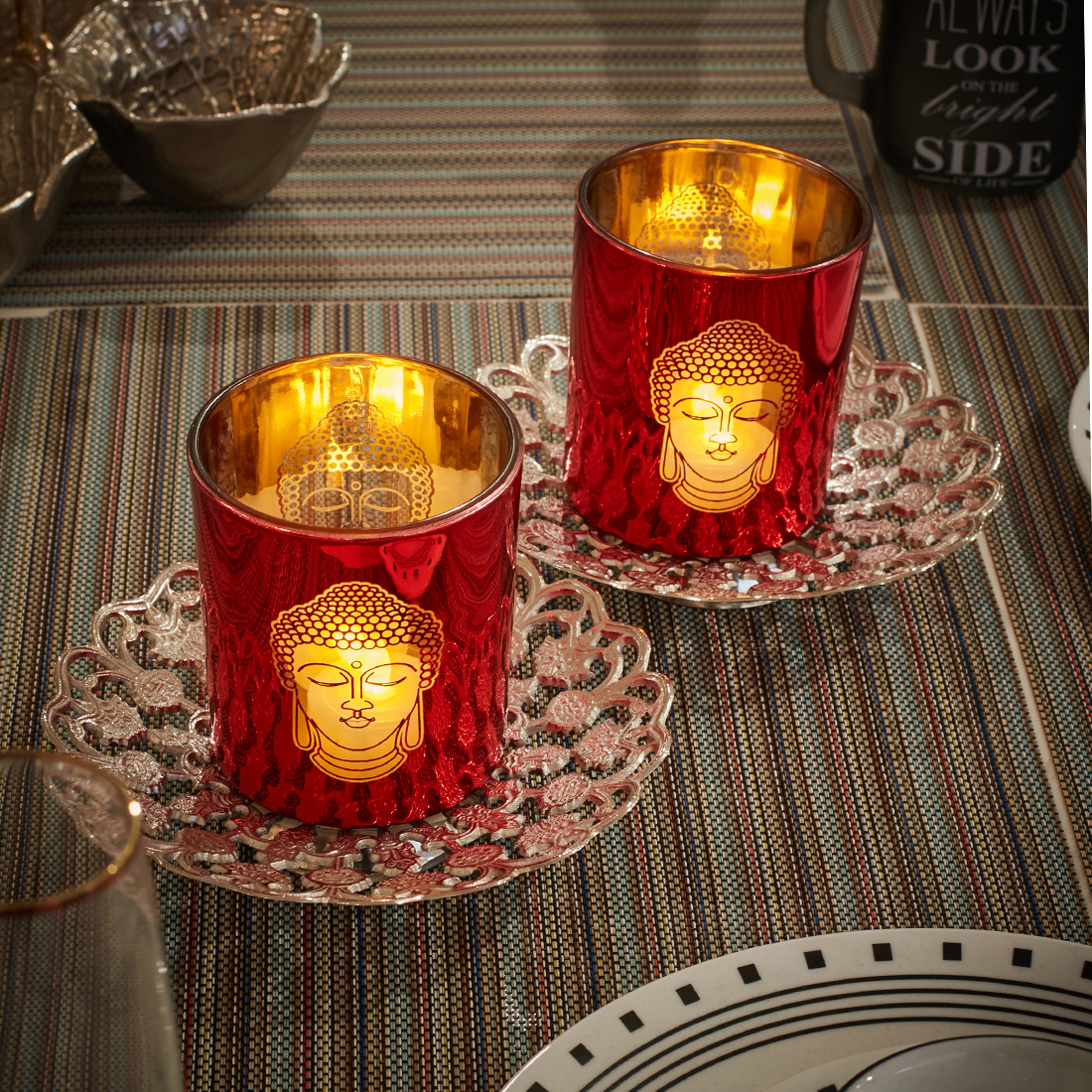 Zahara Set Of Two Etched Buddha Face Metal Candle Holders in Red Colour by Living Essence