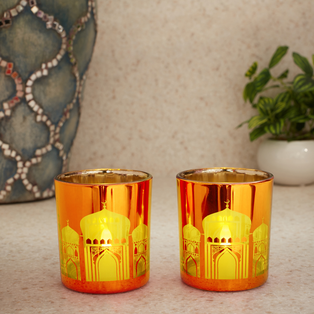 Zahara Set Of 2 Temple Etched Glass Candle Holders in ORANGE Colour by Living Essence