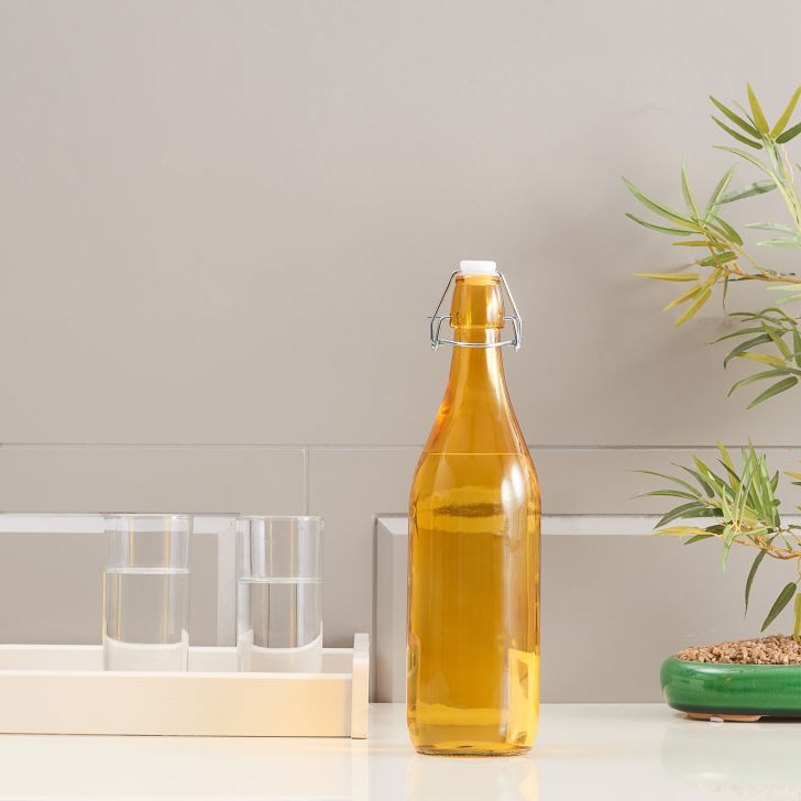 Milan Glass Yellow Clear Bottle 1L in Yellow Colour
