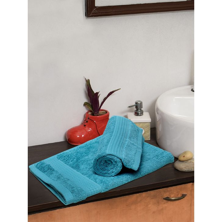 Spaces Cotton Hand Towel in Ocean Colour by Spaces