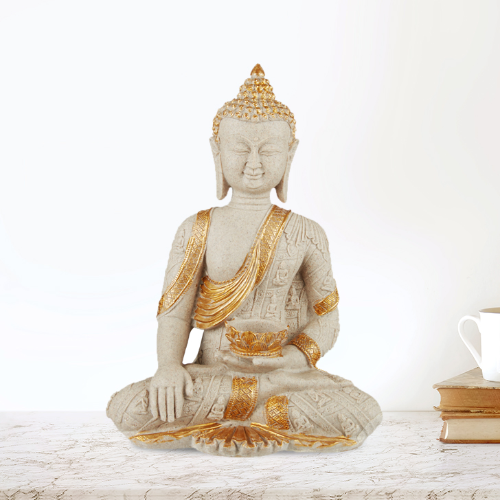 Buddha With Pot In Hand Polyresin Idols in White Gold Colour by Living Essence