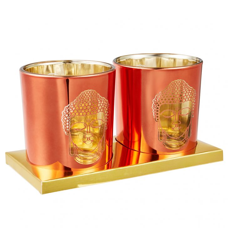 Zahara Set Of Two Etched Buddha Face Metal Candle Holders in Orange Colour by Living Essence