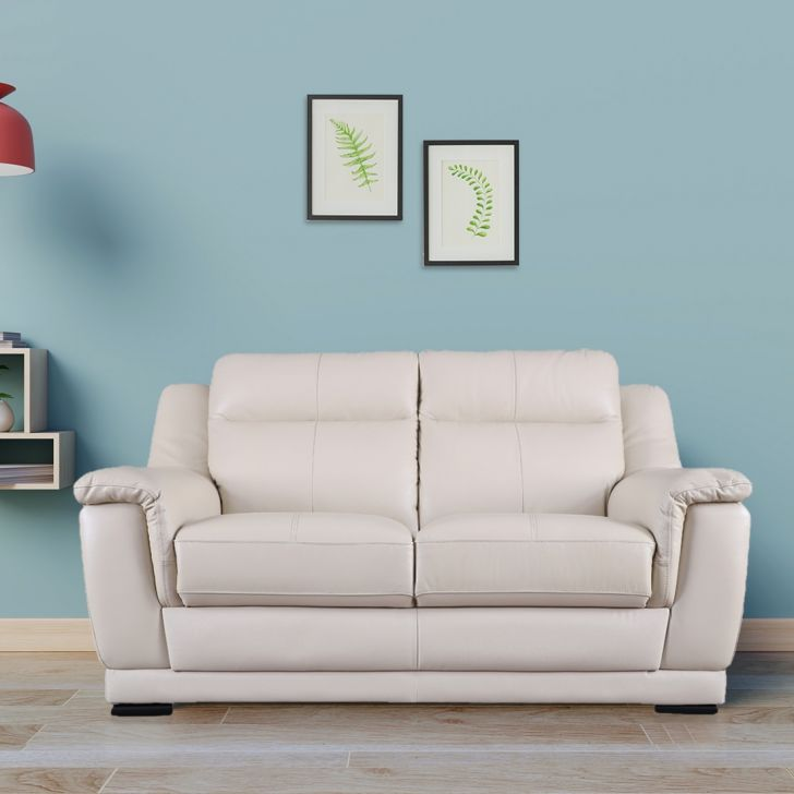 Agata Half Leather Two Seater Sofa in Beige Colour by HomeTown
