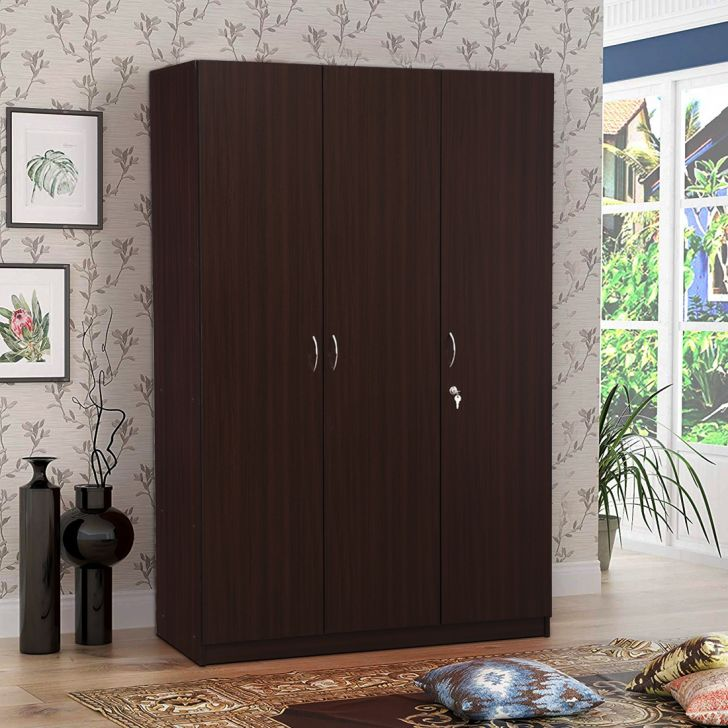 Willy Engineered Wood Three Door wardrobe in Walnut Colour by HomeTown