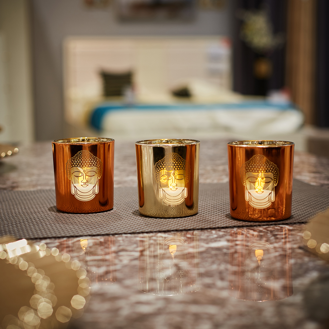Zahara Set Of 3 Buddha Face Glass Candle Holders in ORANGE GOLD Colour by Living Essence