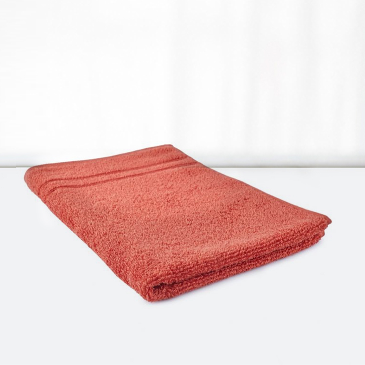 Nora Hand Towel Cotton Hand Towels in Rust Colour by Living Essence