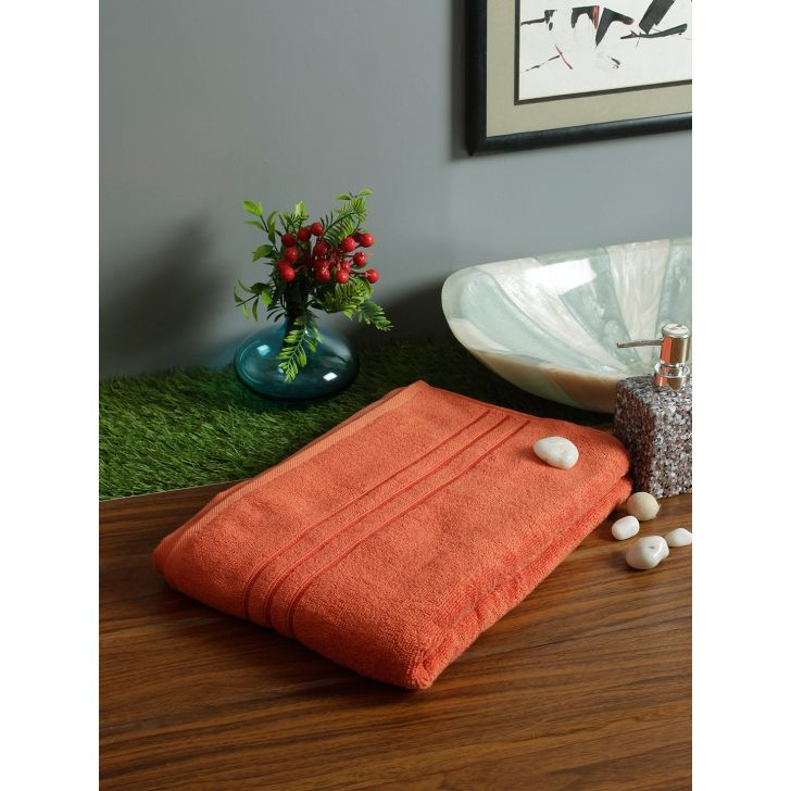 Nora Cotton Bath Towels in Rust Colour by Living Essence